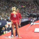 Nastia Liukin chalks up after her fall on bars