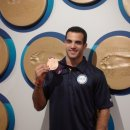 Danell Leyva shows off his Olympic medal