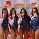 USA Gymnasts pose with their gold medals