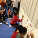 UGA Seniors sign the Wall