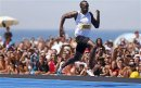Usain Bolt Wins Copacabana Beach 150-Meter Race In Rio De Janeiro
